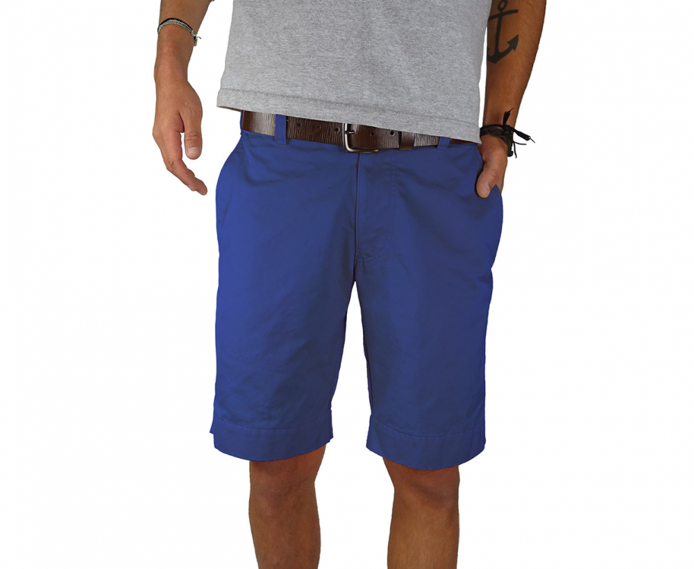 Man standing wearing navy twill shorts - front view