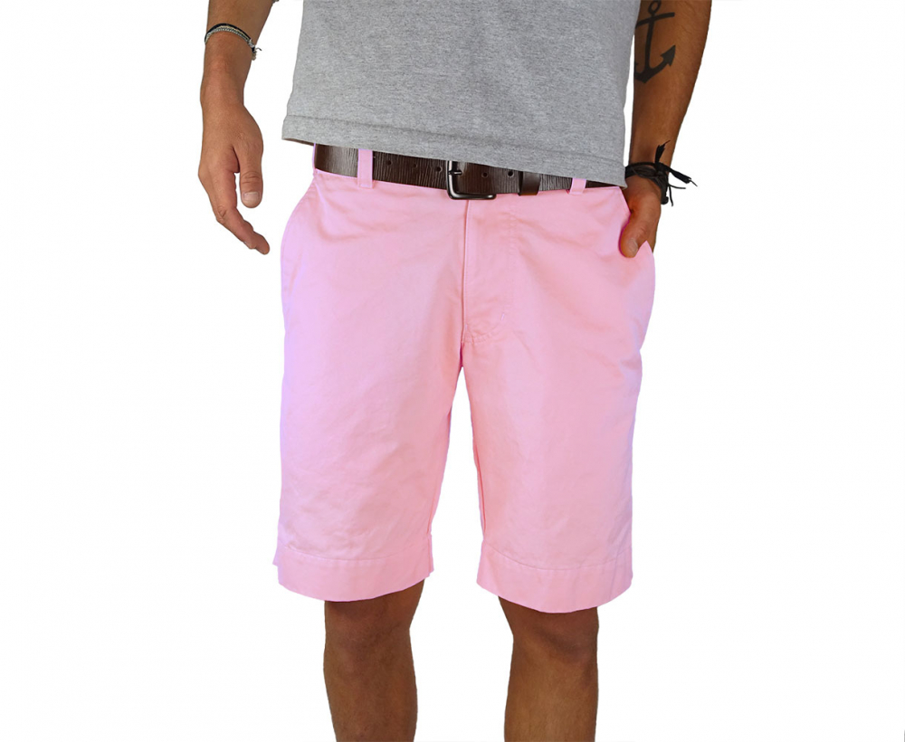 Man standing wearing pink twill shorts - Front view