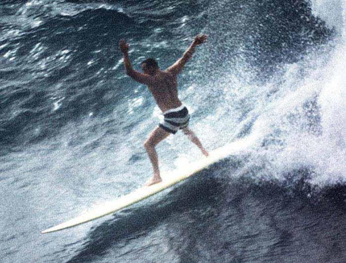 Greg Knoll charging down a wave