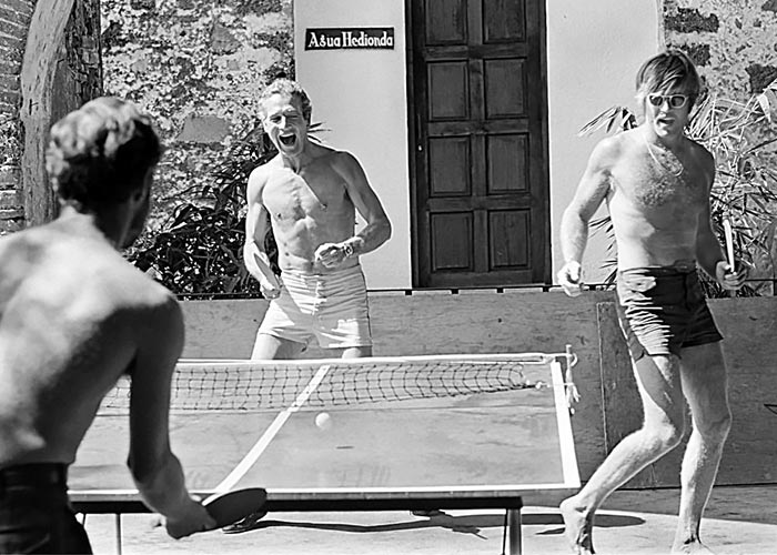 Black & White Photo of Paul Newman & Robert Redford Playing Ping Pong & wearing shorts
