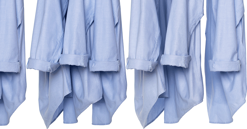 Multiple Blue Oxford Shirts Hanging